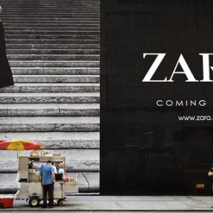 Sep 07, 2008 - New York, New York, United States: A hotdog vendor looks at a woman next to a Zara billboard on 5th Avenue.  (Natan Dvir / Polaris Images)